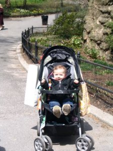 Shorty #1 in NYC with her Grandma - note the bags piled on the back of the stroller!