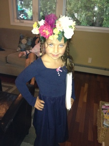 Shorty #1 selects some Coachella inspired headgear for her first day back to school.