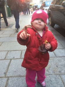 Shorty #2 enjoys a proper chocolate eclair and wonders if she's found poo inside... Tres charmant!